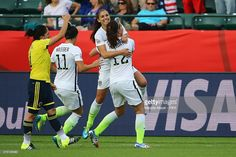 Alex Morgan #13 of United States of America celebrates with Alex Krieger #11 and Lauren Holiday #12 after scoring a goal during the FIFA Women's World Cup Canada 2015 Round of 16 match between the United States and Colombia at Commonwealth Stadium on June 22, 2015 in Edmonton, Canada.