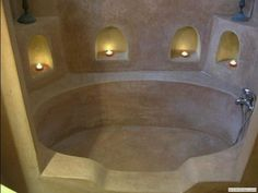 Cob bathtub. I don't like the sharpness of this tub, but I like how big it is and the candle shelves. :)