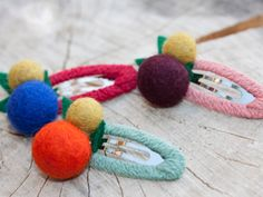 The chilly fall air just around the corner calls for woolly barrettes with jaunty berries. Available at cutiedooty.com, $10.