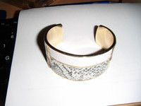 "goldtone clasp bangle faux leather effect 6.5""long 1.5""wide good condition"