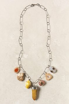 Prong settings!  Nature's Charms Necklace by Melissa Joy Manning for #anthropologie. Recycled sterling silver & 14 K gold, druzy, Montana agate, sunshine cactus quartz, red agate, topaz, irridescent ammonite, & shell
