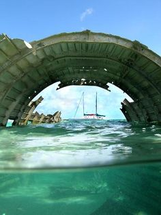 Sunken DC-3 at Normans Cay. The charter sailboat Cat Ppalu in in the background.