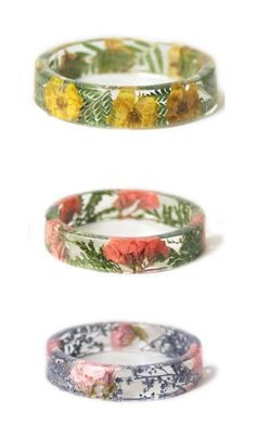 Handcrafted slip on style bangle made with real dried white flowers embedded into water clear resin. #resinringsdiy