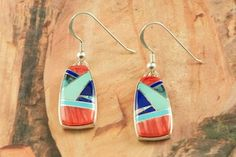 Genuine Turquoise, Spiny Oyster Shell and Blue Lapis inlaid in Sterling Silver French Wire Earrings. Accented with Fire and Ice Lab Opals. Designed by  Navajo Artist Calvin Begay. Signed by the artist.