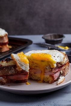 The ultimate ham and cheese sandwich topped with creamy bechamel and a soft fried egg.