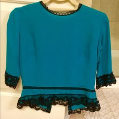 Vintage turquoise silk shirt sleeve blouse Vintage turquoise silk blouse with black lace accents. Falls just above waist. No tags inside. Purchased at a vintage store and never wore. Perfect condition. Fits like an XS. Tops Blouses