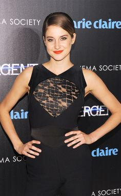 Shailene Woodley looks striking in black with bright lipstick for a pop of color.