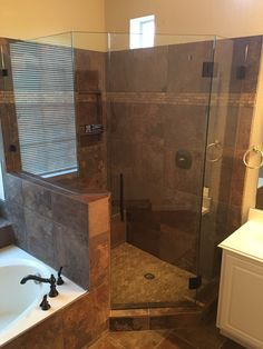 """Frameless shower with glass to glass hinges, mitered corner, Door and 3 panels, 8"""" Ladder Pull Handle, and Oil Rubbed Bronze finish"""