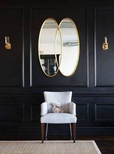 Black-painted hallway or entryway wall inspiration.