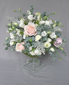 The Bespoke Florist - wire urn with sweet avalanche, paper whites, lisianthus, ranunculus, tulips, eucalyptus and kochia