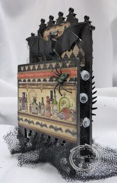Halloween shrine decorated with Graphic 45 papers and lots of Halloween goodies x
