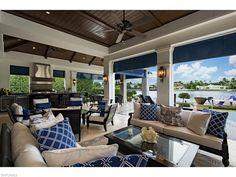 3600 Nelsons Walk, Naples, FL 34102 | Nautical Blue lanai with summer kitchen in Port Royal