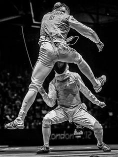 Sergei Ilnitsky won second prize in the sports action stories category with a series title The Golden Touch – Fencing at the Olympics. The picture shows Alaaeldin Abouelkassem of Egypt (top) in action against Peter Joppich of Germany in the men's foil individual competition at London 2012