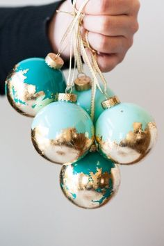 DIY Painted Gold Leaf Ornaments - I'm thinking I could apply this same technique to other things lying around the house!