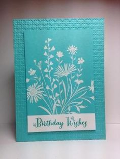 handmade card: Birthday Wishes by beesmom ... monochromatic turquoise with white ... luv the wide mat with embossing folder texture ... silhouette flowers stamped in white on turquoise ... pretty!