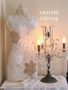 Dress form covered with doilies!What a creative way to decorate a dress form! We sell new and used dress forms at MannequinMadness.com