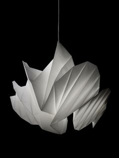 """Issey Miyake lamp. """"IN-EI ISSEY MIYAKE""""  Lighting prototype. The material used is recycled polyester nonwoven fabric. The light is distinct in that it is without structure and created purely from folds."""