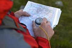 Compass and Map - Cultura/Ross Woodhall/ Riser/ Getty images
