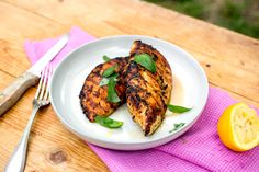 NYT Cooking: Lemon and Thyme Grilled Chicken Breasts - These classic herb and lemon-seasoned chicken breasts will win over fans, especially when cooked over charcoal to give them the deepest, smokiest taste. For dark meat lovers, this recipe will also work with boneless, skinless thighs, though you might have to add a minute or so to the cooking time.