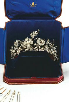 Closer view of a Tiara: gold, silver and diamonds, rose and round cut. The biggest flowers can be removed and used in different ways. Fitted case signed Musy - Torino. Property by a noble Italian family. http://www.cambiaste.com/uk/auction-0209-1/tiara-gold-silver-and-diamonds-rose-and-round--1.asp