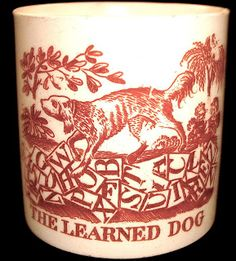 """""""The Learned Dog"""" 2 inches high by inches in diameter Dogs are popular transferware patterns. Baby Dishes, Ceramic Art, Bone China, Red And Pink, Kids Playing, Skull, Peach, Ceramics, Antiques"""