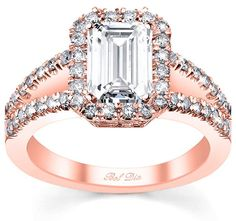 emerald cut halo engagement ring with a split shank set in rose gold from DeBebians' signature collection.  Halo engagement rings first became popular in the 1920's.