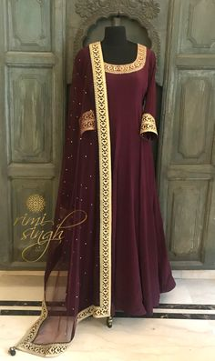 """""""Accept the challenges so that you can feel the exhilaration of victory."""" Deep wine floor length gown in crepe with zari and sequin hand embroidery on the neckline teamed with a matching net mukaish dupatta . There is dori and sequin embroidery on the sleeve edge and four sides of dupatta. Available exclusively at Rimi Singh Studio A 999 Sushant Lok 1 Gurgaon #9818310054. Shadi Dresses, Pakistani Bridal Dresses, Pakistani Dress Design, Dress Indian Style, Indian Dresses, Indian Outfits, Outfits Plus Size, Indian Designer Suits, Kurti Designs Party Wear"""