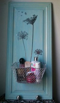 DIY makeup holder. Repurposed cabinet door. Waverly chalk paint in pool blue 60684E. Dollar tree wall deco stickers. Finished and sealed with Minwax water based Polycrylic protective finish.