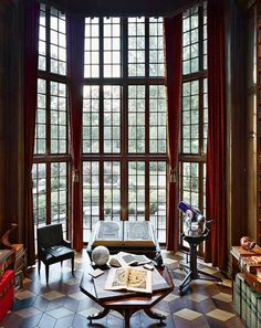 Gorgeous windows in this 3600 sq. ft.  Library in the home of Jay Walker, internet entrepreneur.