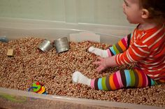 I got this tub of beans idea from Sew Liberated, who was a trained as a Montessori teacher and has lots of great ideas for the toddler set on her blog.