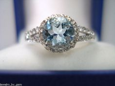 Aquamarine engagement ring...  I really love this! Maybe in a princess cut!