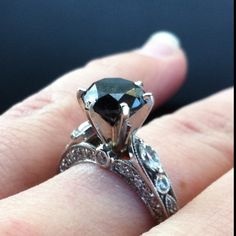 Finally got my beautiful one of a kind  engagement ring! 2.53 carat black diamond surrounded by .35 carats diamonds and pave work in white gold <3