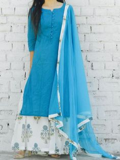 """DESCRIPTION: This outfit includes a turquoise mulmul kurta fully lined. It is paired with a blue hibiscus block printed pleated sharara pants with elasticated belt along with a net dupatta with border detailing. FABRIC: Handblock mulmul LINING: mulmul SIZE: XS : chest = 32"""" ; upper waist = 24"""" lower waist = 26"""" ; sle"""