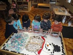 """This week I had a tray of smooth, clear class pieces on display, along with an apple, carrot, banana, zucchini, pretend (rubber) peanuts, a minature raccoon and a copy of our read aloud, """"Sadie The children had a blast, and did something similar to the photo above posted by a Reggio kids blog."""