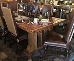 The rustic Barnwood Dining Table Timber Frame Design #3 appears as though it has been transported through time from Abraham Lincoln's farmhouse to be dropped in your dining room. The massive barn wood timbers used for the table base are solid wood salvaged from 100 to 150 year old Midwestern barns.  The antique barn wood planked