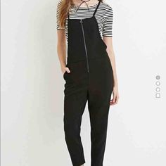 """Black front zip jumpsuit A sleeveless jumpsuit featuring an exposed front zipper, buttoned straps that crisscross in back, and a square neckline. Slanted front pockets, back welt pockets Partially lined, woven Shell: 95% polyester, 5% spandex; Lining: 100% polyester 43"""" full length, 35"""" waist to hem, 26"""" inseam, 30"""" waist, 22"""" chest Forever 21 Other"""