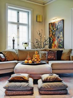 Moroccan style seating with cushions. I like the floor pillows