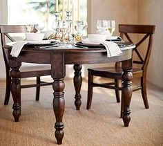 This would be so awesome in your kitchen dining area. Shown here with the aaron dining chairs in rustic mahogany.Evelyn Extending Round Dining Table #potterybarn