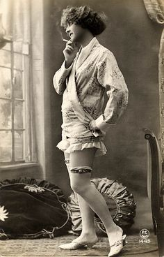 The garters, the slides. By hairstyle, woman smoking, must be 1920's. ALady Vintage french postcard