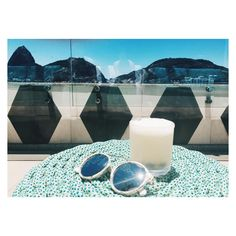Sunglass and cocktails at the rooftop bar at yoo2 hotel in botafogo rio de janero overlooking the sugar loaf. traveling brazil on vacation chill relax traveling inspiration blog: Worldstoryliving.com