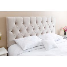Crafted of a wood frame and upholstered in a stunning ivory wood and velvet, this headboard will add style to any bedroom. Perfect for any queen or full size bed, this Connie Tufted Headboard from Abb