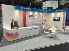 Wide angle view of the custom build exhibition stand (space only) created by Urban Display for Allergan Botox. Features included a raised floor, large internal storage space, private consultation room, demonstration areas, an informal seating area and hospitality bar.