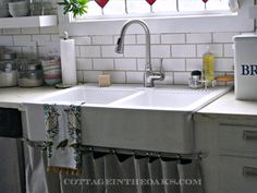 Double farmhouse sink from Ikea!  Reasonable price.  I'm thinking about this for our kitchen.  I love the curtain underneath.