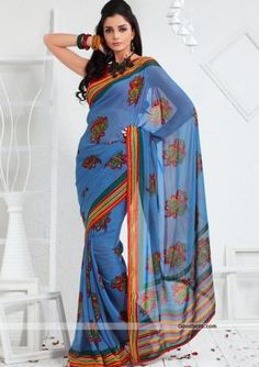 Get a designer look wearing this blue shade saree designed with floral prints. Multicolored pallu and border looks trendy with fancy lace. It will look good for casual parties. $35.00 http://goodbells.com/saree/floral-printed-blue-saree.html