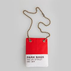 Park Bag Necklace  Get rid of that fanny-pack looking waste bag carrier! Wear this handy and stylish necklace out on your dog walks and you'll have a discreet source of waste bags right at your fingertips. Later hang your pouch neckpiece with the leash, on the rear-view mirror or on your key hook for the next outing.  100% nylon, ball and chain necklace with one 24-bag waste refill pack include
