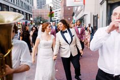 Getting married at Old South Meeting House means you're just a few steps away from all the delicious restaurants Downtown Crossing has to offer for your reception. Being escorted by your own brass band is optional!   Mazel tov to Elana and Jen on your beautiful wedding! Photography by Alex Paul.