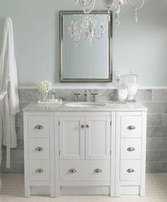 bathroom remodel. Love the chandelier in the bathroom