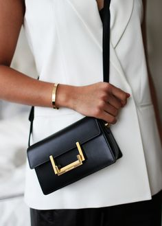 I want a purse like this but maybe more gold details. d33a1d3f6d6c4