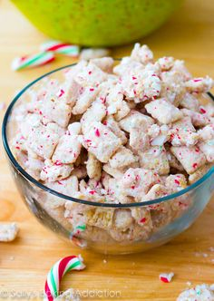 Peppermint Crunch Puppy Chow aka Muddy Buddies. Easy, no-bake sweet treat for the holidays. sallysbakingaddiction.com