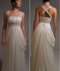 Such elegant details the jeweled criss-cross straps, draped sides and ruched bust.  Love it!